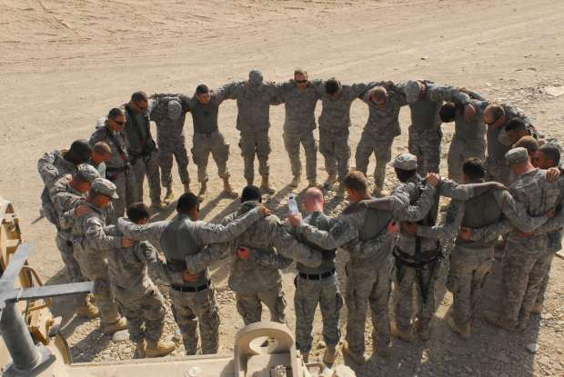 The Soldiers from 3rd Platoon, 62nd Engineer Company, 4th Engineer Battalion pray before a mission. Although not all of the Soldiers are religious, they all join in to be a part of the circle and pray before every mission.